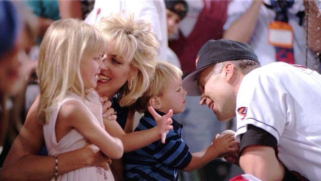 Ryan Ripken, 2, Rachel, 5, and Kelly Ripken play with Cal Ripken are pictured before his record-breaking game. (Karl Merton Ferron)