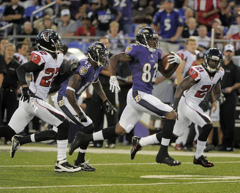 Ravens wide receiver Torrey Smith sprints away from the pack for a touchdown in the first quarter against the Falcons on Thursday.