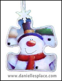 Snowman puzzle piece Christmas Ornament Craft from www.daniellesplace.com
