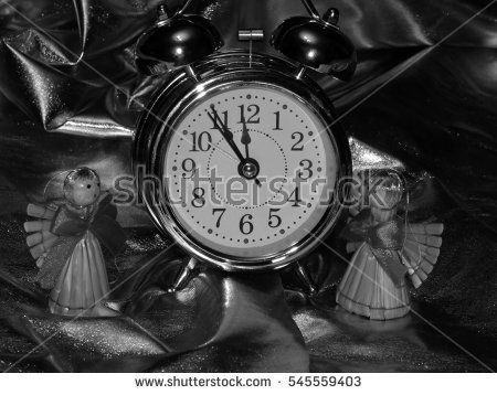 New Years angels with the alarm clock on a black and white image