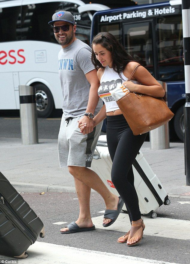 Home again: Newly-engaged Ricky Rayment and Marnie Simpson arrived back from their Zante h...