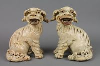 "Lot 161 A pair of 18th Century cream glazed figures of Dogs of Fo 9"", f,  est  £100-200"