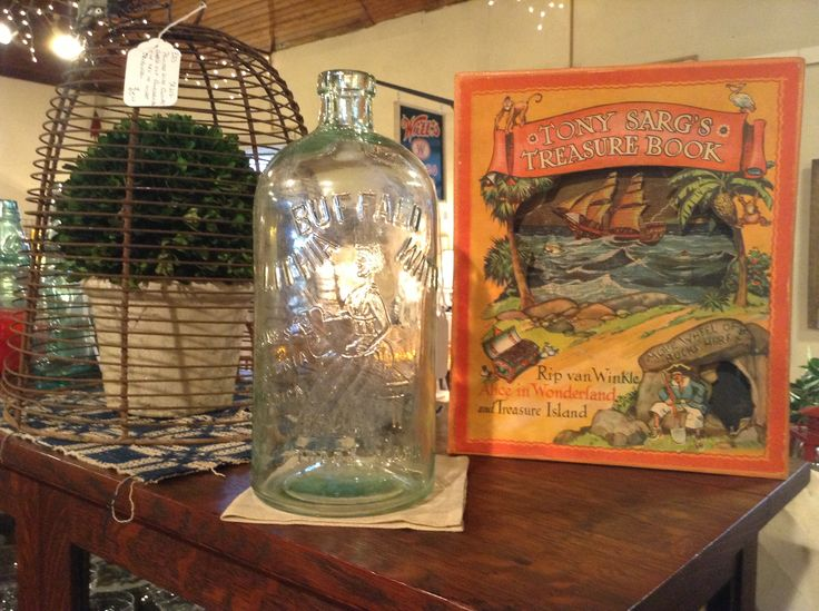 Antique Lithia Water Bottle and Antique Tony Sarg's Treasure Book at Harris Hall of Antiques in Troutville Va