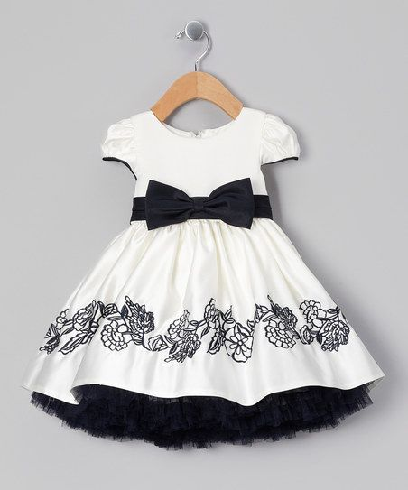 Tiny trendsetters live to dress up and this frock is just the functional, fashionable piece to do it. From its eye-catching embroidered skirt to the cap sleeves and big bow, the details will turn heads and warm hearts.