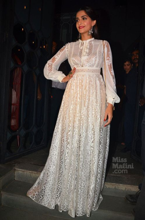 Sonam Kapoor at Sanjay Leela Bhansali's Party : Sonam effortlessly pulled off this white Elie Saab maxi dress with a Dolce & Gabbana sling bag and dangling earrings. She looked good.