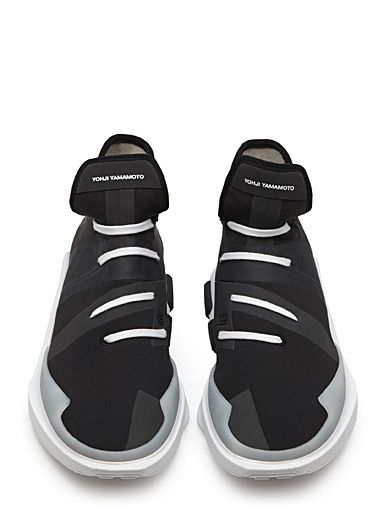 The athletic trend reaches new heights as Y-3 draws influence from science fiction, creating a supple sneaker to accent your urban looks. Made from monochrome techno material with a quick-lacing design, it is the very essence of creative and modern fashion expertise. - Mixed media techno construction combining neoprene and rubber - Coated details on top - Suede heel insert - Internal lacing - Cushioned leather insole - Strong rubber outer sole - Signature storage bag included - Model number…