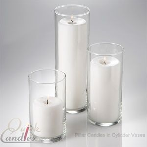 Set of 3 Glass Cylinders & 3 Pillar Candles ~ $24.99 ~ Perfect centerpiece option complete with the candle color of your choice!   One of each size and 3 coordinating Pillar candles