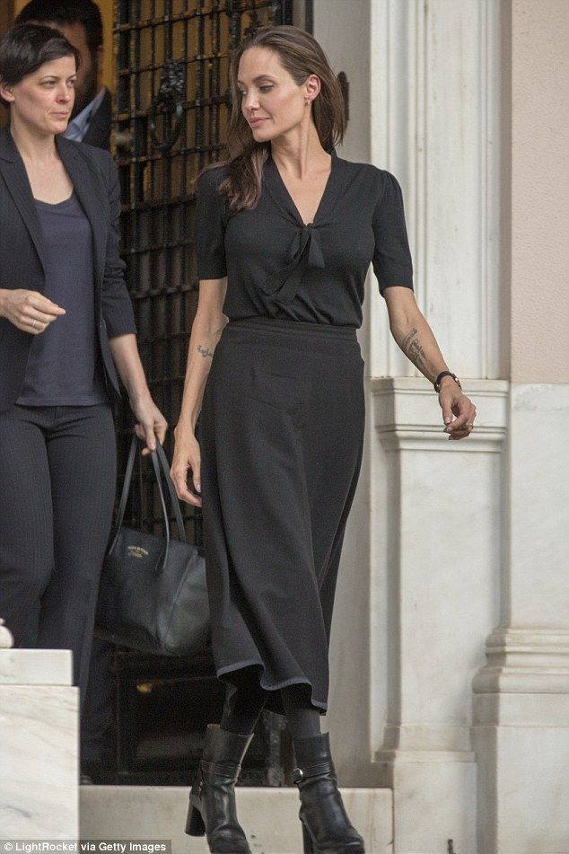 Back to black: Angelina Jolie manages to juggle the Hollywood life with her UN and charity...