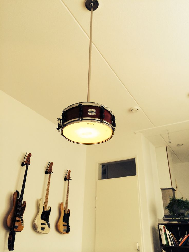 Selfmade snare drum lamp. In the background my Fender Jazz Bass guitars