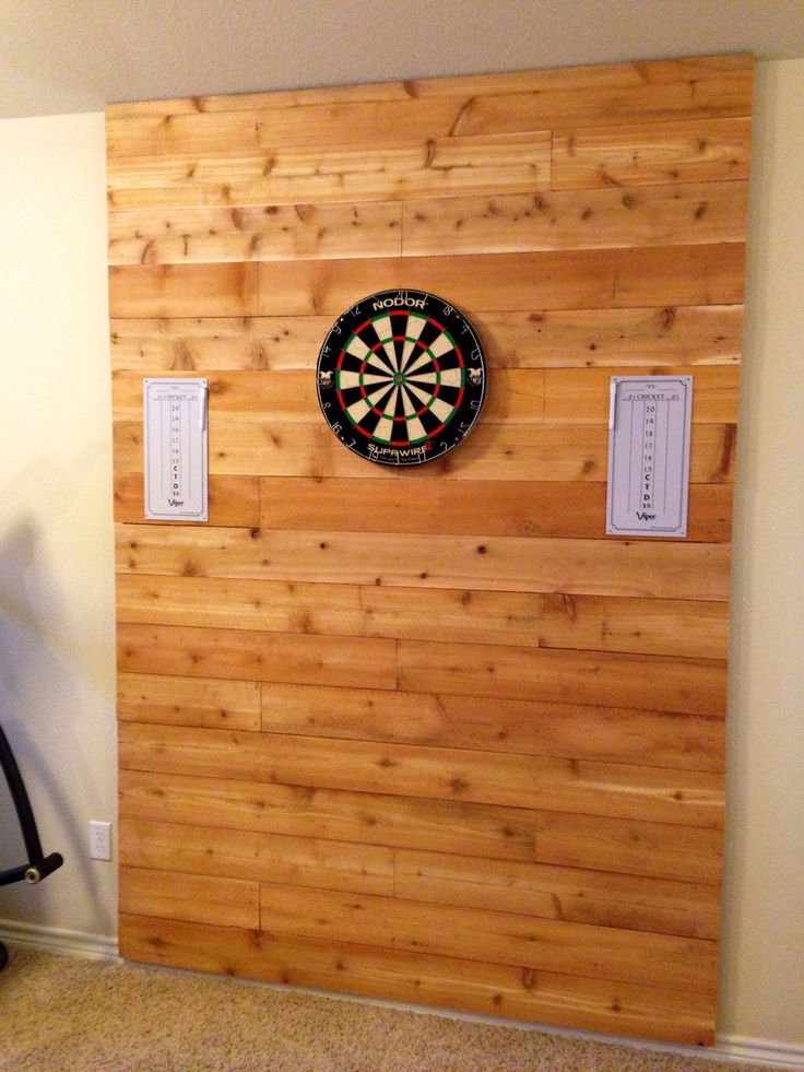 Dart board with accent wall for the game room! And we actually did it ourselves!