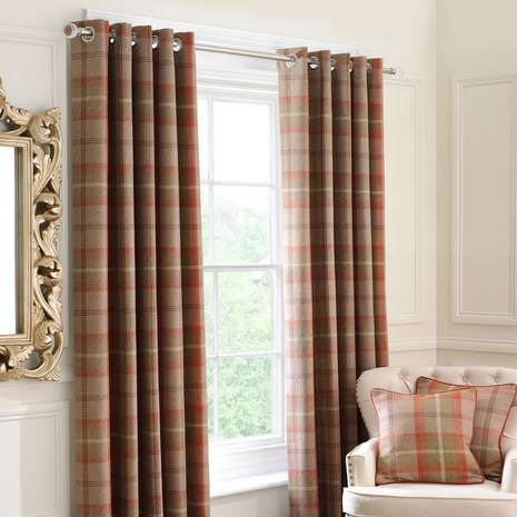 Featuring a rustic check pattern in orange tones, these ready made eyelet curtains are fully lined to retain warmth and minimise draughts from entering, availab...