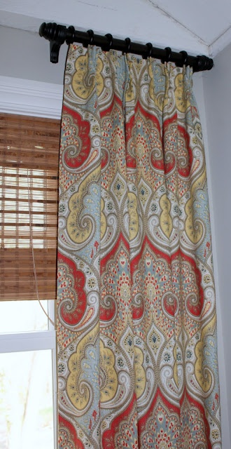 new family room window treatments idea--Love the way to transition from gold/red formal areas to blue in tv room