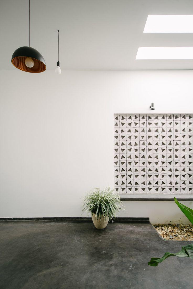 Vietnamese house featuring homemade concrete blocks