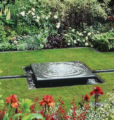 A shallow water fountain water garden features for Pond features and fountains