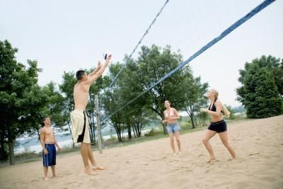 The regulation height of a volleyball net depends on certain factors, such as if the game is being played by men or women, as well as the age of the players involved and the number of players on a team. Whether the game is being played indoors or out also plays a role in determining the height. Volleyball nets are measured in the center of the...