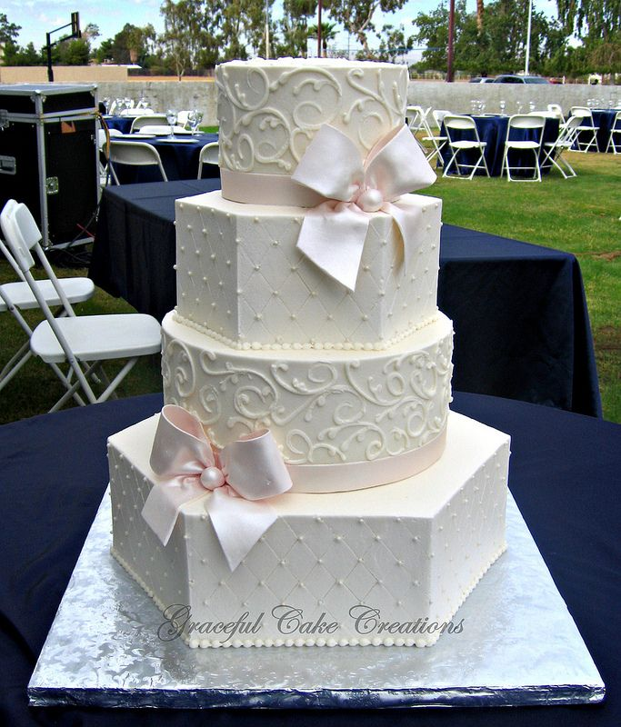 Elegant Ivory Buttercream  Hexagon and Round Wedding Cake with Blush Pink Ribbon and Bows | by Graceful Cake Creations