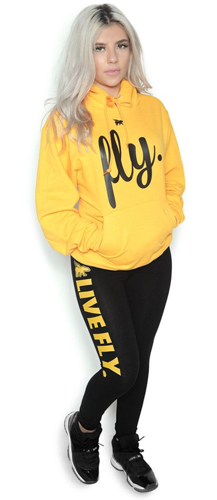 FOREVER LIVE FLY. OUTFIT: GOLD HOODIE/BLACK LEGGINGS