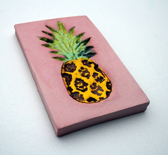 Ceramic tile featuring a super bright pineapple printed in. Gorgeous bright yellow, soft unglazed pink and a brown wash on the pineapple.