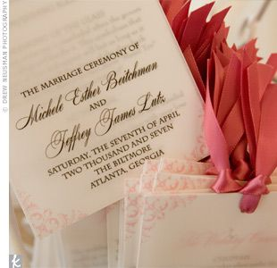 The pink and white programs used the same swirl design that adorned the invite
