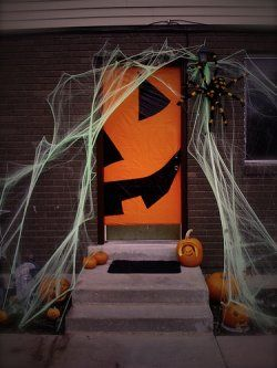 Here are a few silly and simple ideas for decorating your front doors for Halloween.