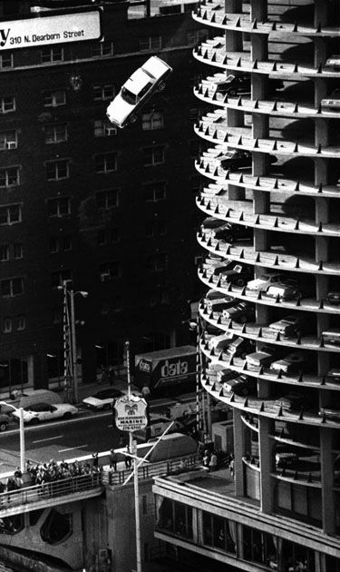 "A sedan plunges from the 15th floor parking garage of Marina City into the Chicago River in 1979 during a movie stunt performed for Steve McQueen film called "" The Hunter"""
