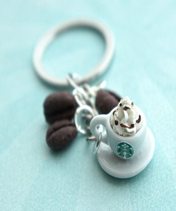 this key chain features a miniature cup of starbucks coffee along with some handmade espresso bean charms sculpted from polymer clay. the entire key chain length is 3 inches.