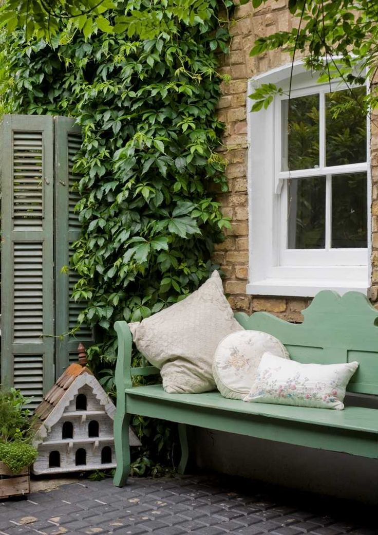 Love the bench and the use of the shutters as movable privacy screen.