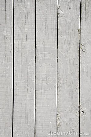 The wood grain is apparent through the white paint on these boards.