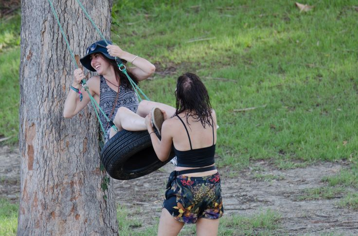 Festival guests having fun on a tyre swing.  Fun is contagious:)  http://byronbaycampinghire.com.au/