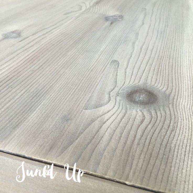 DIY wood stain (vinegar and steel wool), followed by Varathane wood stain in Weathered Gray and then a wash of Annie Sloan Chalk Paint® in Old White. Sand with 220.