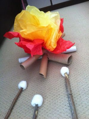 Paper towel rolls, tissue paper, and cotton balls on sticks make this fun indoor camp fire!