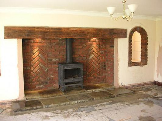 Beautifull brick fireplace and woodburning stove