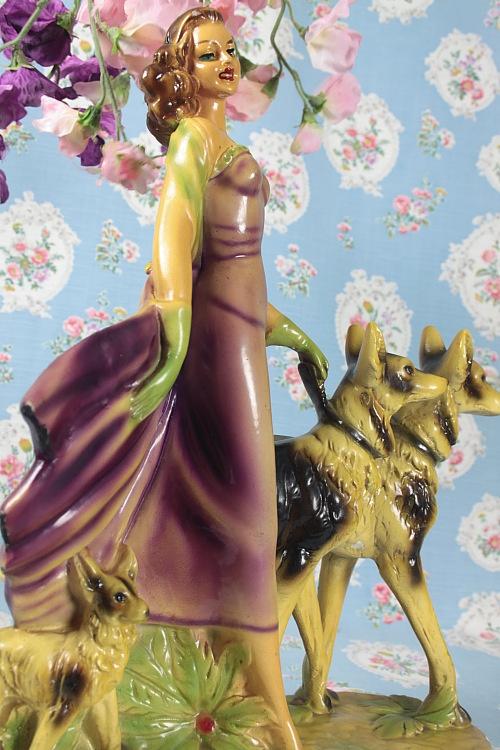 Fabulous deco figurine of lady walking her dogs!