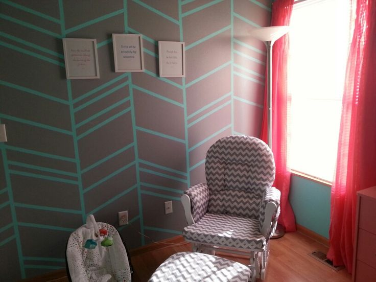 Stork Rocker/Glider with ottoman. Herringbone accent wall (Office Gray and Tantalizing Teal from Sherwin Williams). Pink curtains from Target.