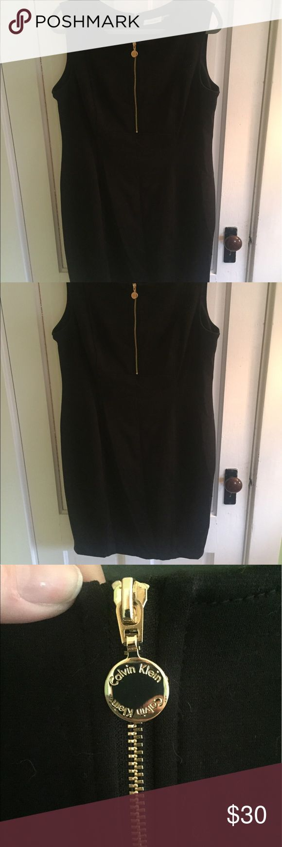 Black Calvin Klein dress with gold zipper This is a lovely black dress. Perfect for work and going out! Only worn once and in perfect condition. Great length for work, but the gold zipper adds a little pizzaz! Calvin Klein Dresses