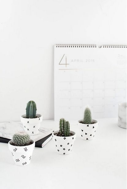 If you can doodle, you can definitely make these because they're that easy! We're celebrating Earth Day with these DIY patterned mini plant pots for your succulents via Homey Oh My.