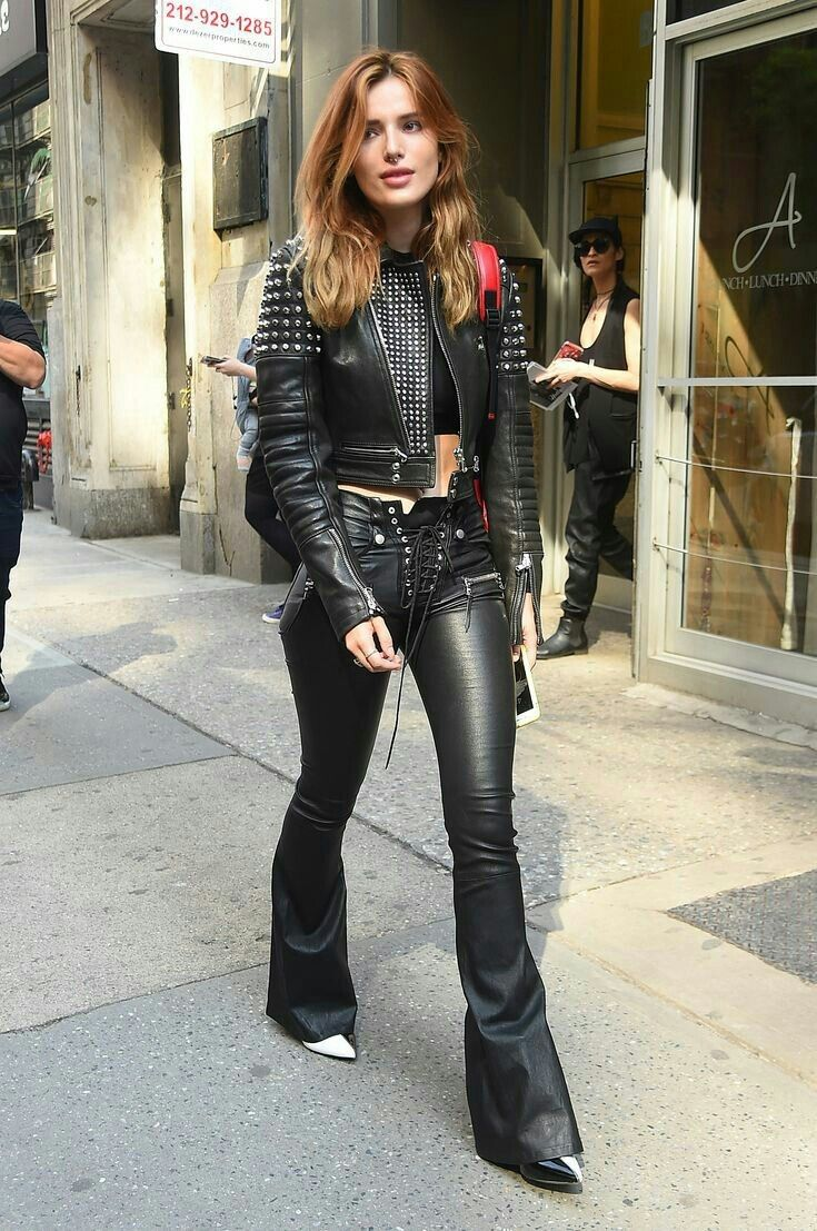 46a53bad043c4a Bella Thorne 👄 in flare front lace up leather pants and leather jacket.  Chic leather street style 💋