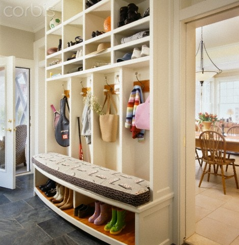builtin coat and shoe rack in foyer