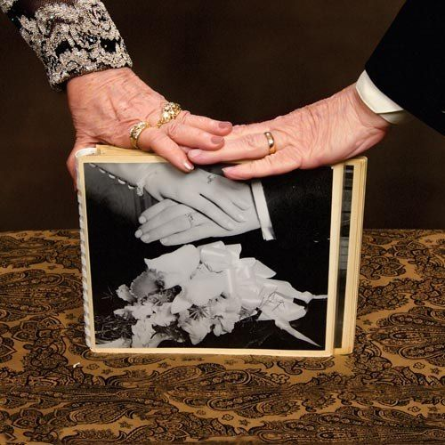 "Romantic idea for a 40th or 50th wedding anniversary...Have the happy couple redo their ""ring photo"" next to their original one. I think it's a powerful representation of their true love and time together."