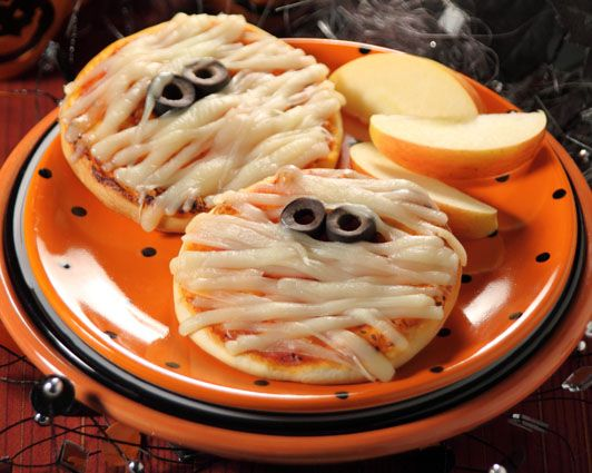 "Mummy Mini Pizzas - 10/27/12 (Giles Halloween Party) - cut slices of provolone and mozzarella into strips for the mummy ""wrappings"" instead of pulling apart string cheese"