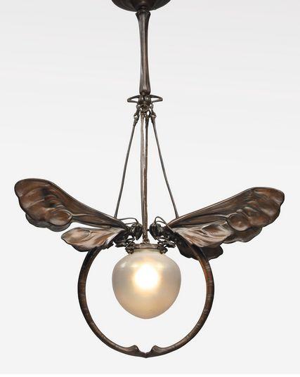 European Art Nouveau Chandelier. Patinated bronze and glass, 34 x 23 x 5 1/2  in. (86.4 x 58.4 x 14 cm), circa 1900.