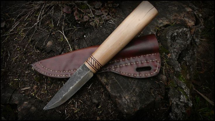A simple handforged puukko with handsewn natural leather sheath. Stylized for viking-age knife, but it's not a replica.