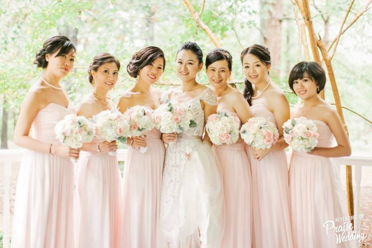 Everything from the Bride's glittering wedding dress to the blush bridesmaid gowns evokes femininity and romance!