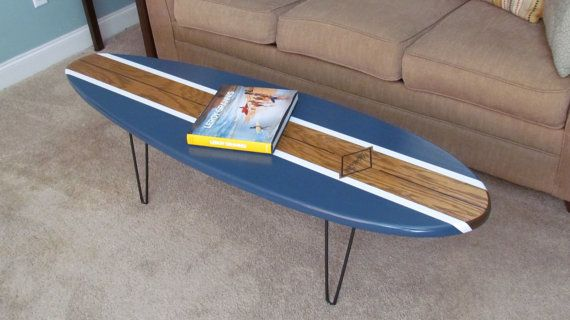 This board has realistic features and dimensions of a real surfboard. The board is 5 6 Long by 19 1/2 Wide and 1 1/2 Thick. This coffee table stands 16 1/2 tall. It is made of furniture grade plywood and finished with four coats of varathane. We take a few extra steps to wet sand and polish our boards to give it a durable and mirror glossy finish. We offer customization for this item.  International Orders please note your surfboard table will be 60X 19X 1 1/2 due to shipp...