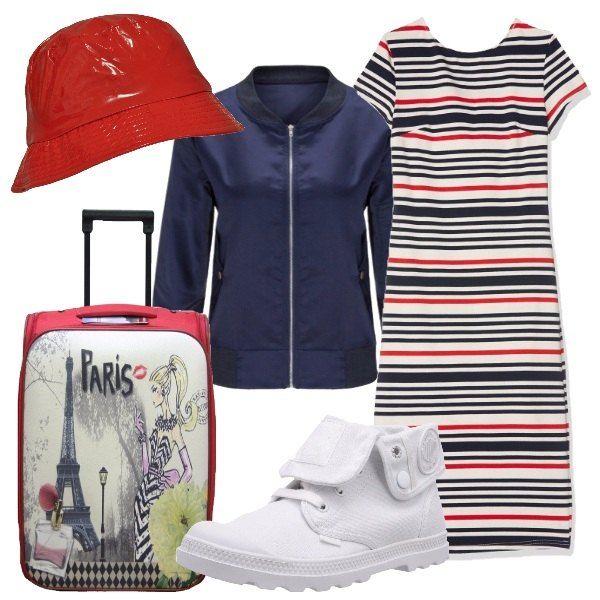 Sia per i colori sia per il bagaglio a mano questo insieme ricorda molto la Francia. Abito lungo in cotone, giacchetto blu e cappello rosso, unito alla borsa da viaggio con stampa. Per i piedi scarpe comode da passeggio,