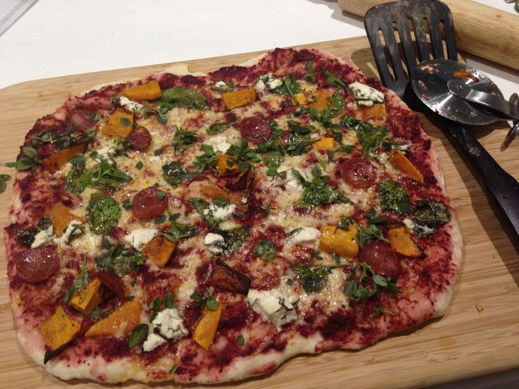 Finished pizza. Persian feta, beetroot sauce, spinach, roasted pumpkin and chorizo.