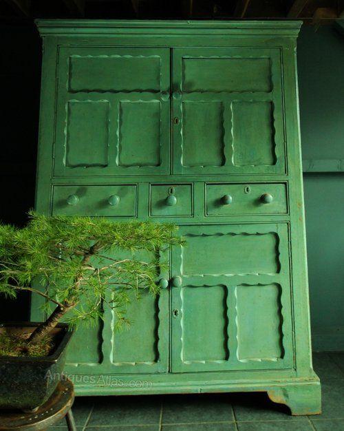 A good Irish country pine food cupboard .