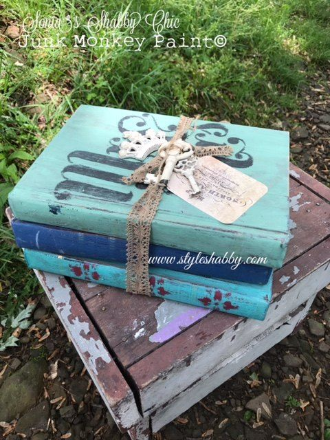 I would have never thought to paint the outside of books, great idea.  How to Upcycle Old Books Into Cute Home Decor!