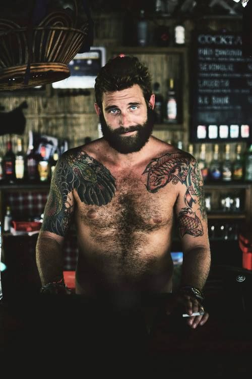 I need him in my life. Look at his beard. And his eyes and his tattoos. Oh my lord. I don't know who this man is, but I need to find him and take him off the market.