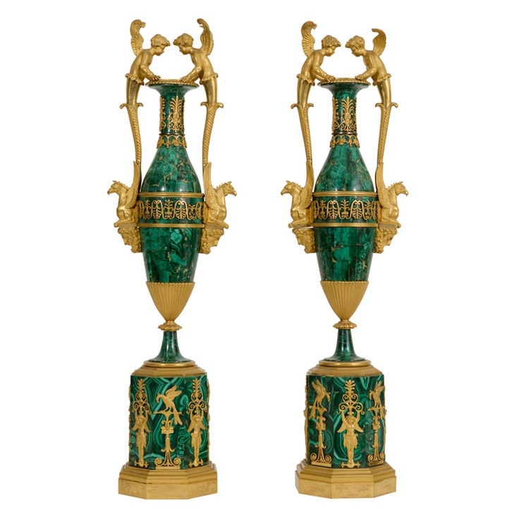Pair Malachite and Gilt Bronze Urns, c. 1800  Russian Federation  Circa 1800  Pair of Russian Ormolu-Mounted Malachite Vases, St. Petersburg, c. 1800; Each with applied anthemia and flanked by putti and griffin-form handles.